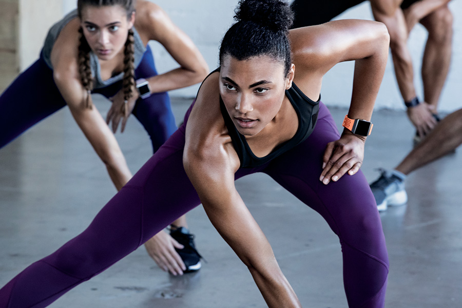 Woman wearing Fitbit Ionic working out