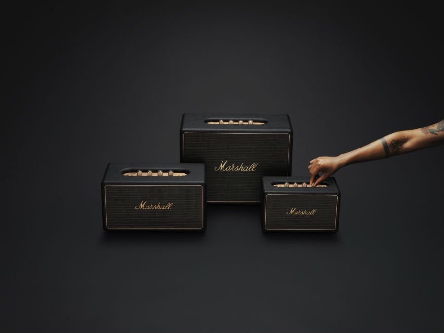Hand touching Marshall Wireless Multi-Room System set in black