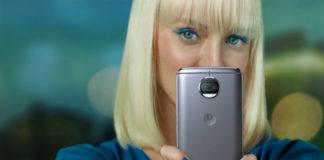 Woman holding Motorola G5s Plus in Lunar Gray