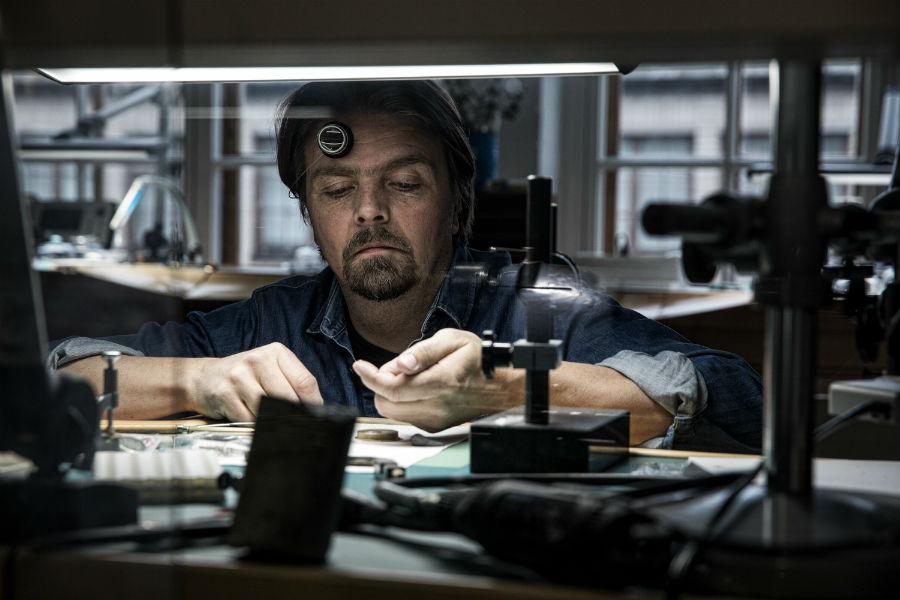 Watchmaker working on gold moons