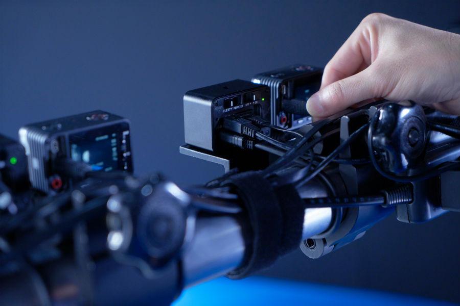 Photographer adjusting Sony RX0 camera