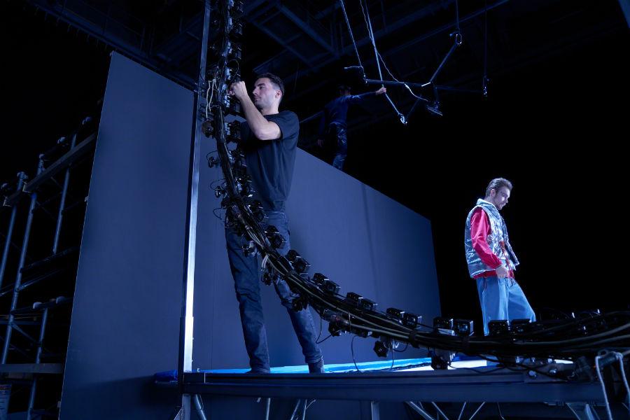 Photographer adjusting angle of Sony RX0 cameras