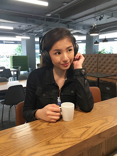Vanessa listening to Sennheiser HD 4.40 BT Wireless Headphones