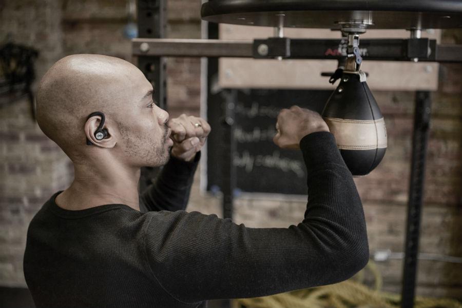 Man using M4U TW1 earphones while boxing