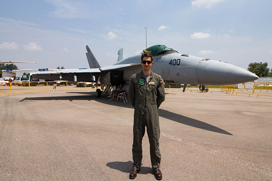 Man from the US Navy and an F18 in the background