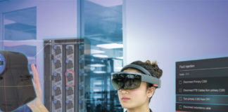 Woman using Microsoft HoloLens and Honeywell Connected Plant Skills Insight Immersive Competency to train