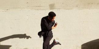 Man dancing to a radio