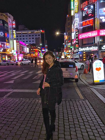 Vanessa on a Korean street at night