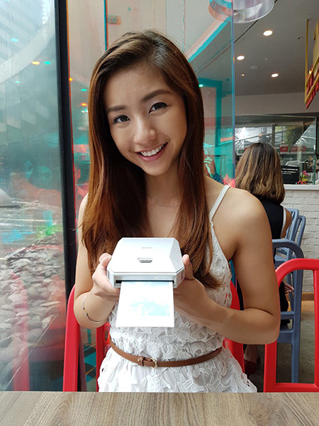 Vanessa holding the instax Share SP-3