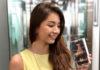 Vanessa holding a Nokia 2