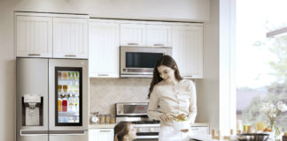 Mother and child in a kitchen with LG Side-by-side refrigerator