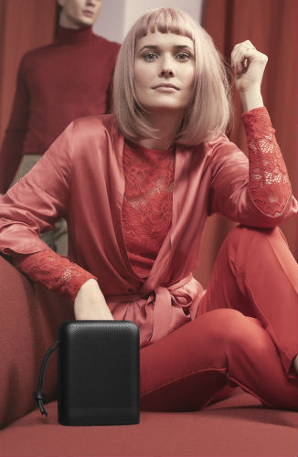 Woman in red with Beoplay P6