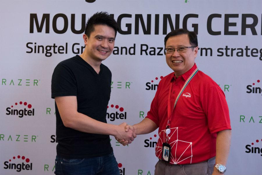 Razer and Singtel representatives shaking hands