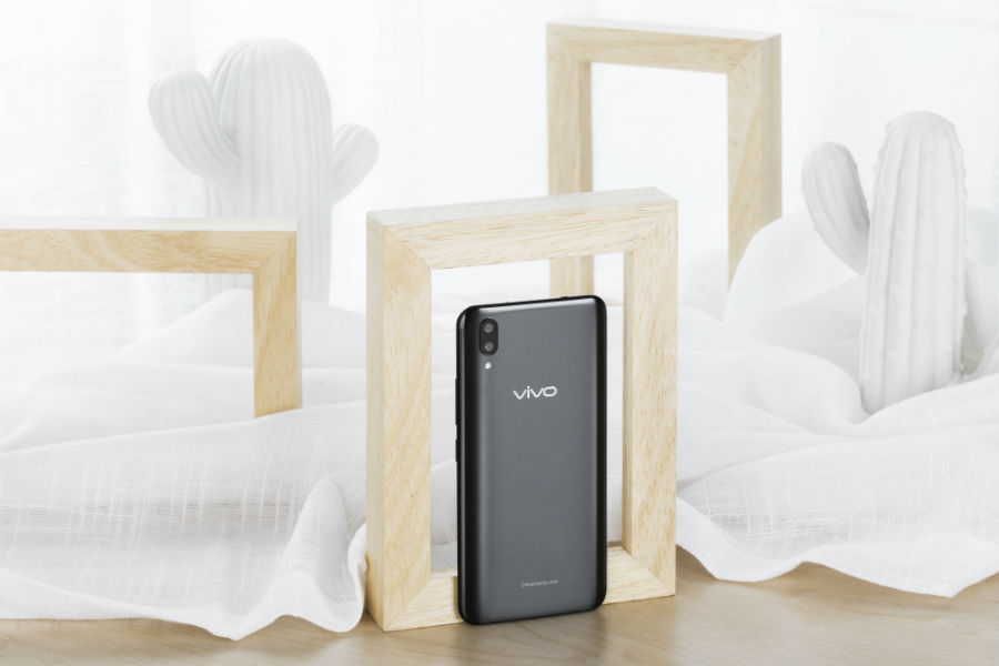 Vivo X21 in wooden frame with white cloth and cacti around