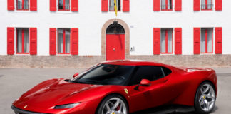 Ferrari SP38 in front of building