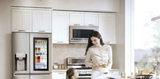Mother and child standing in front of LG Side-by-side refrigerator