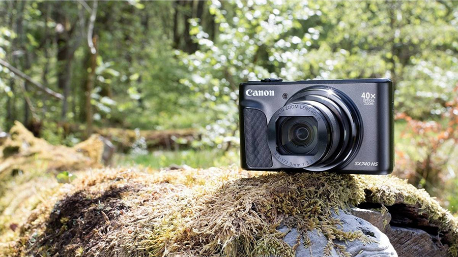Canon PowerShot SX740 HS resting on a rock