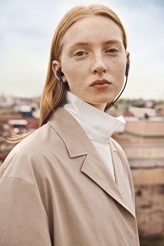 Beoplay E6 earphones worn on model