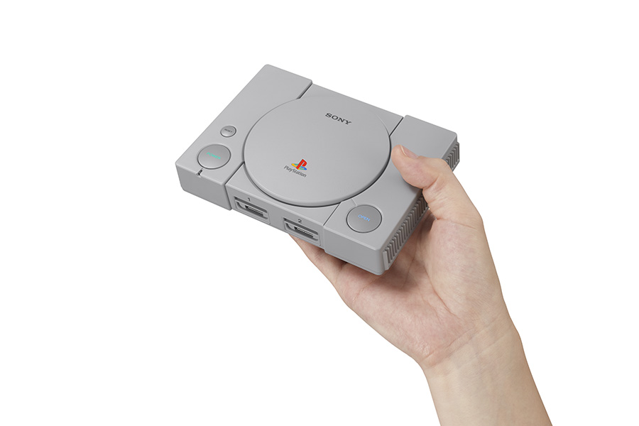The PlayStation Classic held in a hand