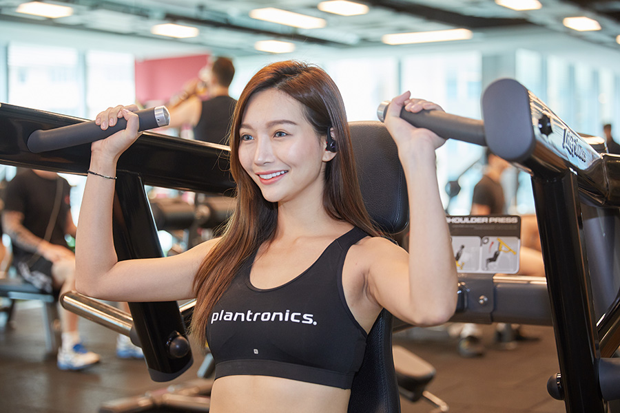 Model for Plantronics using fitness equipment with BackBeat FIT headset