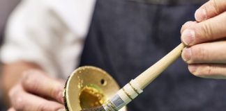 Gilding the Dyson Supersonic 23.75 karat gold hair dryer by hand