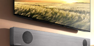 LG SL9YG Soundbar mounted under a tv
