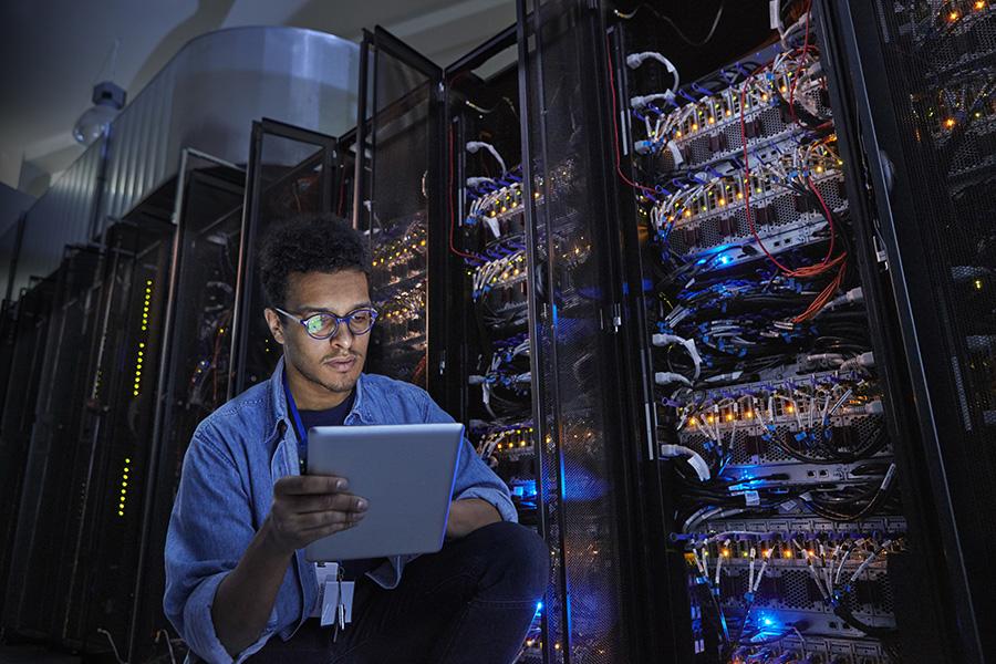IT technician in data centre server room