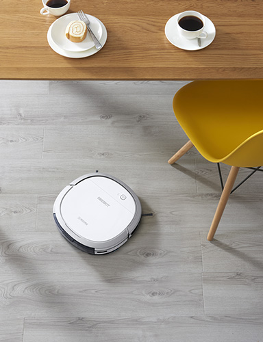DEEBOT OZMO Slim11 robot vacuum under a table