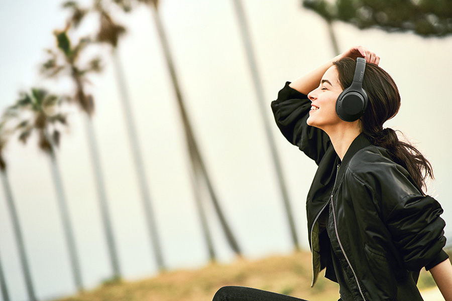 Woman enjoying the WH-XB900N