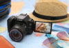 Canon EOS 200D on a table with various items