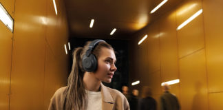 Woman wearing Jabra Elite 85h wireless headphones