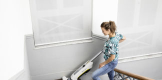 Woman using the Karcher FC 5 Cordless floor cleaner