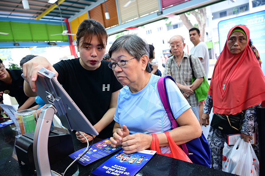 Elderly woman trying out an activity at Go Safe Online 2019