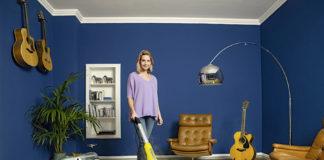 Woman using the Karcher SC 3 Upright EasyFix Steam Mop