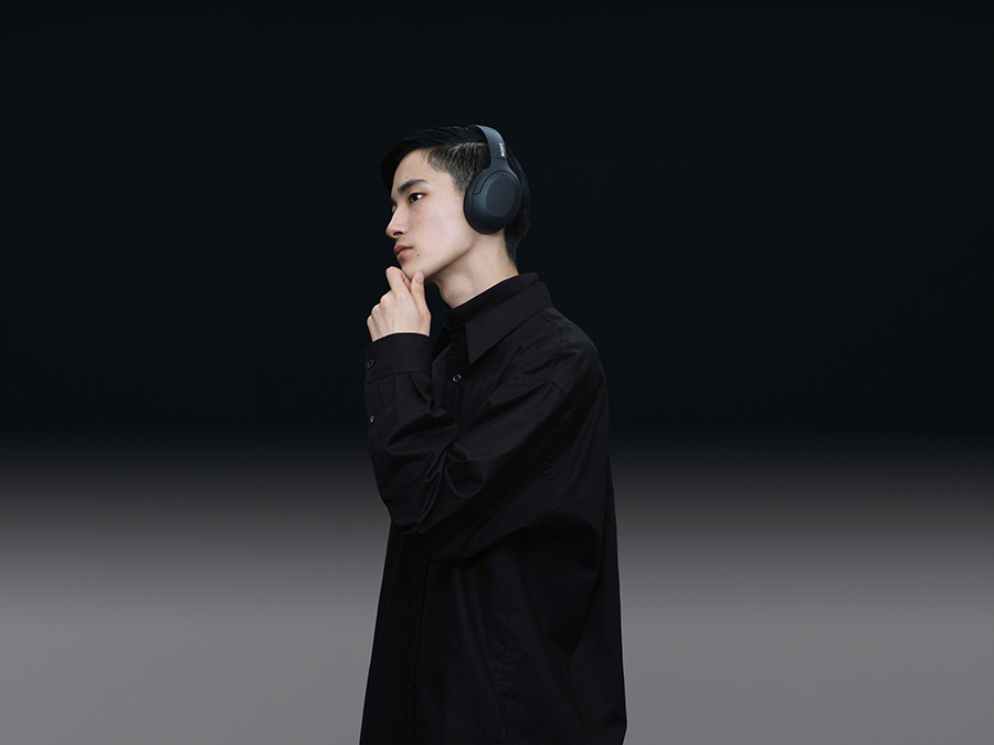 Man listening to WH-H910N