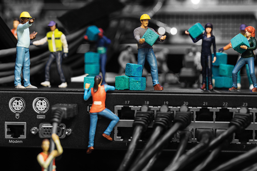Miniature figures working at a data centre run with DCIM