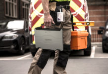 Man carrying Panasonic Toughbook 55