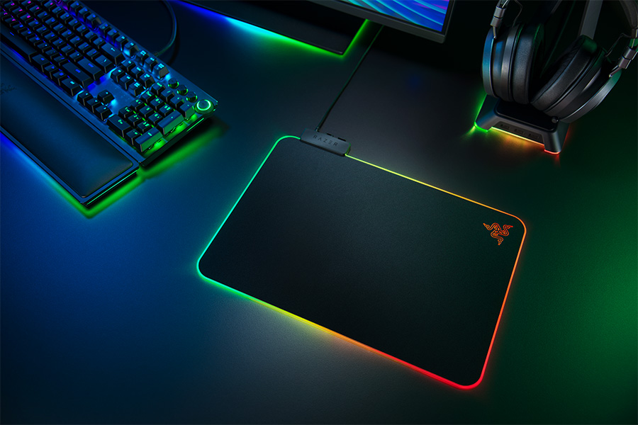 Razer Firefly V2 with other peripherals showing off RGB lighting