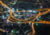 Aerial view of Bangkok Highways at night with traffic lights