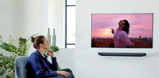 Lady looking at an LG OLED TV
