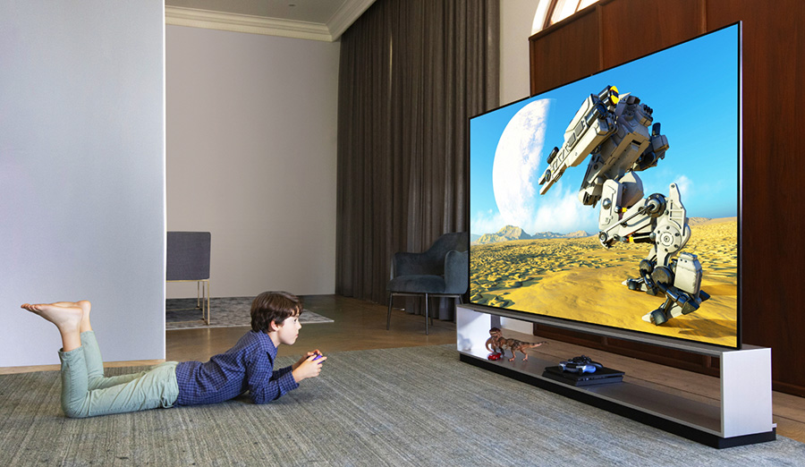Boy playing games on LG OLED TV