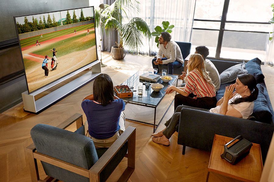 Family watching sports on LG OLED TV