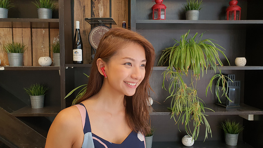 Vanessa working with the Huawei Freebuds 3