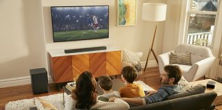 Family watching a soccer match with the JBL Bar 9.1