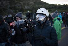 Renata Brito covering protests in the Spain-France border