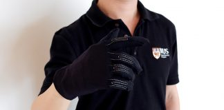 The Infinity Glove is embedded with thread-line microsensors to produce accurate three-dimensional positions of a moving hand, allowing users to mimic a variety of in-game controls using simple gestures. Photo credit: National University of Singapore