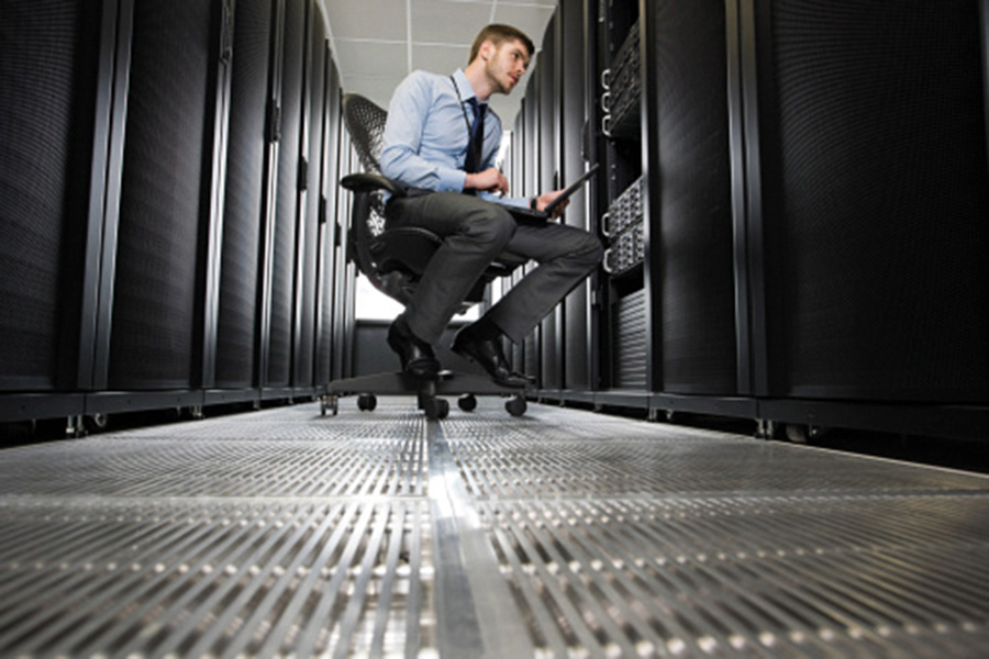Computer technician working on a server